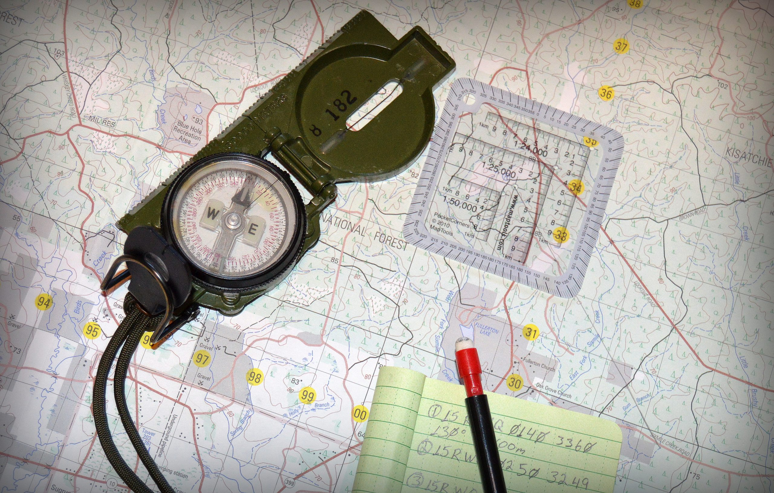Basic tools used for Map Reading and Land Navigation are the Map, Protractor, Lensatic Compass, Pencil and Paper.